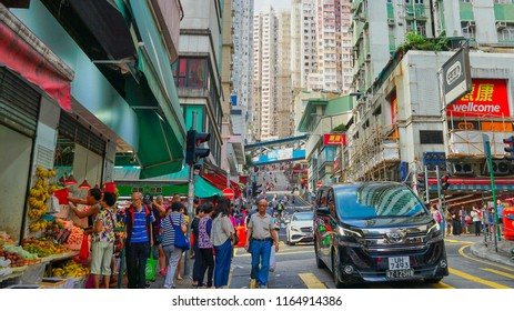 Hong Kong - May 3rd 2018: Streets of Hong Kong with people engaging in daily activity on Sunday afternoon.