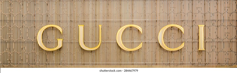 HONG KONG - MAY 5, 2015: Gucci store at night. Gucci is an Italian fashion and leather goods brand was founded by Guccio Gucci in Florence in 1921. Gucci has about 425 stores worldwide.