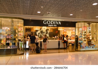 HONG KONG - MAY 5, 2015: Unidentified people at Godiva shop in Hong Kong. Godiva Chocolatier is a manufacturer of premium chocolates founded in Belgium in 1926.