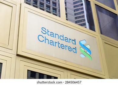 Hong Kong - MAY 6, 2015::Standard Chartered Bank's regional headquarters building in Central, Hong Kong.