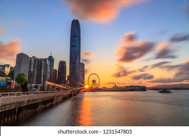 Hong Kong, May 6, 2018: Magnificent cityscape on both sides of Victoria Harbour (sunset view of IFC, the tallest building on HK island)