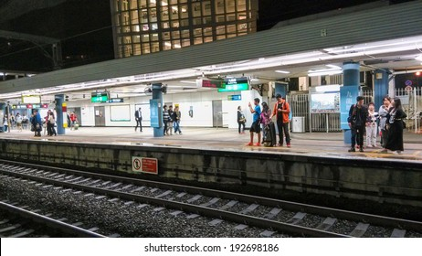 HONG KONG - MAY 7, 2014: Unidentified people waiting for a subway train in Hong Kong. Mass Transit Railway (MTR) is the most popular transport in Hong Kong.