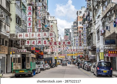 HONG KONG - MAY 8: Billboards in the old street on May 8, 2015 in Hong Kong. With land mass of 1104 km and 7 million people, Hong Kong is one of most densely populated areas in the world.