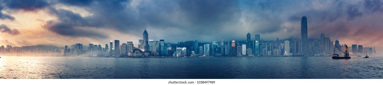 Hong Kong morning cityscape panorama from across Victoria Harbor