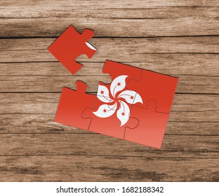 Hong Kong national flag on jigsaw puzzle. One piece is missing. Danger concept.