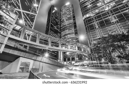 Hong Kong night cityscape with car light trails.