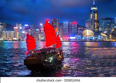 hong kong night view with junk ship on foreground