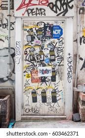HONG KONG - NOV 14, 2013 - Graffiti covered door in Hong Kong