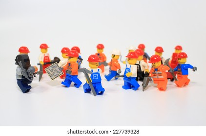 HONG KONG, NOV 2: A group of workers lego mini characters from different genation which are isolated on white in hong kong on 2 november 2014. Lego minifigure are the successful line in Lego products
