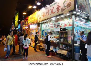 HONG KONG - NOV 21: Unidentified people awaiting food from a stall on November 19, 2014 in Hong Kong. Hong Kong is one of the most vibrant food capitals in the world.