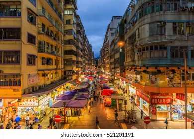HONG KONG - NOV 23,2016: Crowded market stalls in old district on NOV 23,2016  in Hong Kong. Hong Kong is one of most densely populated areas in the world Mong Kok street market in HONG KONG