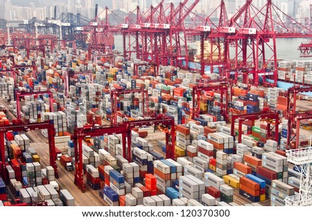 HONG KONG -Nov 24: Containers at Hong Kong commercial port on Nov 24, 2012 in Hong Kong, China. Hong Kong is one of several hub ports serving more than 240 million tonnes of cargo during the year.