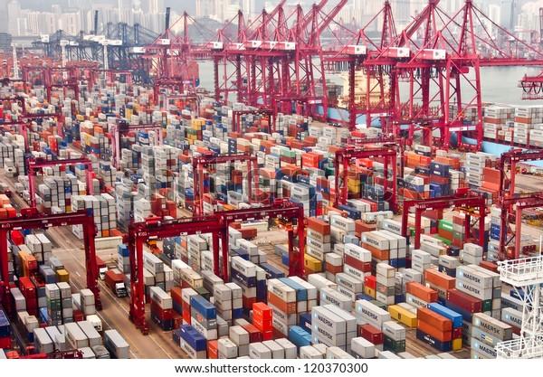 HONG KONG -Nov 24: Containers at Hong Kong commercial port on Nov 24, 2012 in Hong Kong, China. Hong Kong is one of several hub ports serving more than 240 million tonnes of cargo during the year.