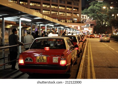 HONG KONG - NOV 27: Toyota Crown Comfort cab at the taxi rank in Tsim Sha Tsui. November 27, 2010 in Hong Kong, China