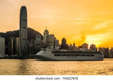 Hong Kong - November 1, 2015 : Big cruise ship sailing from Victoria harbor. And sunset in Hong Kong.