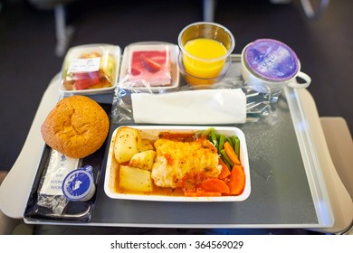 HONG KONG- NOVEMBER 10, 2015: meal in Economy Class of a Singapore Airlines. Singapore Airlines Limited is the flag carrier of Singapore which operates from its hub at Changi Airport