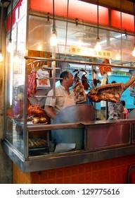 HONG KONG -Â?Â? NOVEMBER 18: Typical street restaurant.  With more than 12000 street stalls Hong Kong is one of the most vibrant food capitals in the world. November 18, 2005 in Hong Kong, China