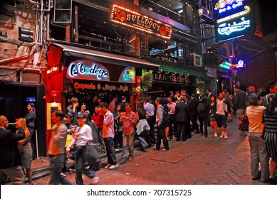 HONG KONG – NOVEMBER 22, 2007: night life in Lan Kwai Fong. The place is one of Hong Kong most popular nightlife hot spots.