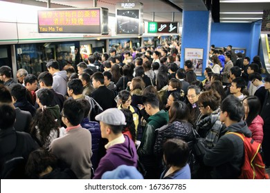 HONG KONG, NOVEMBER 29: crowd of passengers are waiting in Kowloon Tong station on 29 nov 2014. The crowd because the signal failure and transport accident again in MTR subway