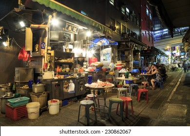 """HONG KONG - OCT 13: Cooked-food stall on Oct 13, 2014 in Central, Hong Kong. The stall is also called """"dai pai dong"""" in Chinese, is a type of open-air food stall once very popular in Hong Kong."""