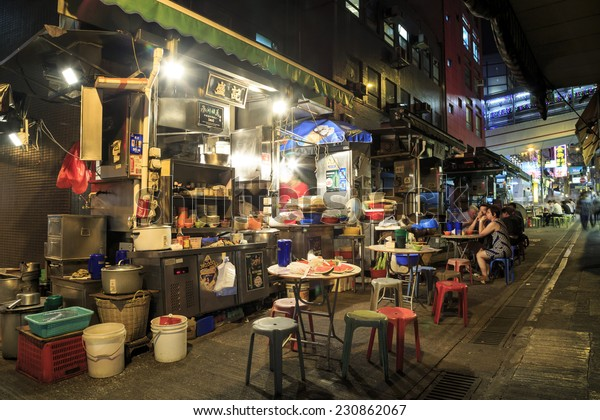 "HONG KONG - OCT 13: Cooked-food stall on Oct 13, 2014 in Central, Hong Kong. The stall is also called ""dai pai dong"" in Chinese, is a type of open-air food stall once very popular in Hong Kong."