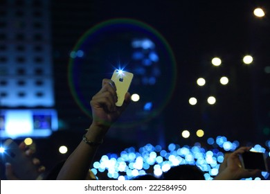 HONG KONG, OCT 2: protesters raise up the phone for the peaceful rally in admiralty on 2 October 2014.after police fire tear shell to the peaceful protest, tension is raised