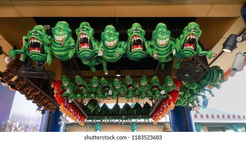 Hong Kong - Oct 5, 2016 : A photo of lots of Slimer plush dolls hanging as rewards in the game zones inside the amusement park. Slimer is a green ghost character from the Ghostbuster the movie (2016)