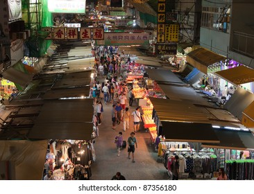 HONG KONG - OCTOBER 01: The Temple Street night market on October 01, 2010 in Hong Kong. The late night shopping is quite typical for Hong Kong culture.