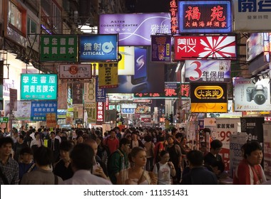 HONG KONG - OCTOBER 06: Unidentified shoppers at Temple Street night market on October 06, 2010 in Hong Kong. The late night shopping is typical for Hong Kong culture.