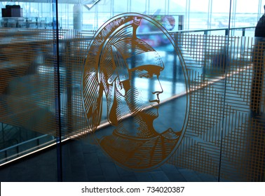 HONG KONG, HONG KONG – OCTOBER 10 2017: American Express Centurion logo on display at the AMEX Centurion Lounge at Hong Kong International Airport, with an unidentified lounge guest inside.