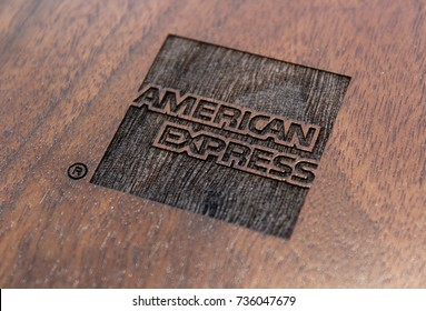 HONG KONG, HONG KONG – OCTOBER 10 2017: American Express logo on display at the AMEX Centurion Lounge at Hong Kong International Airport, set on a wooden background.