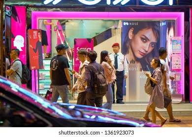 HONG KONG - OCTOBER 14, 2018: Tourists and locals on the street of the Asian metropolis at the night time..