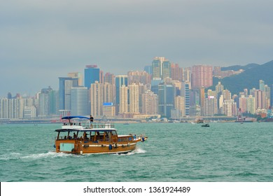 HONG KONG - OCTOBER 14, 2018: Tourist boat in Victoria harbour.