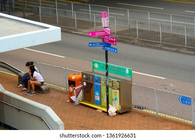 HONG KONG - OCTOBER 14, 2018: General waste trash can in a row with separate garbage collection trash cans.