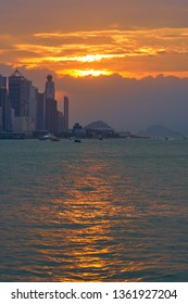 HONG KONG - OCTOBER 14, 2018: Spectacular view of Victoria Harbour at sunset time.