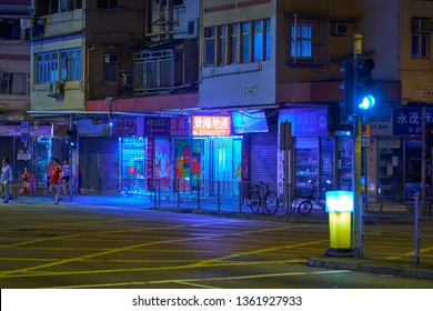 HONG KONG - OCTOBER 14, 2018: Bicycles parked on the sidewalk of the road in the Asian metropolis at the night time.