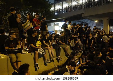 HONG KONG - OCTOBER 20: some of the 120000 protesters staying at Government Headquarters at Tamar at night during the protest against TV licensing decision on October 20, 2013 in Hong Kong.