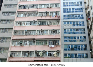 HONG KONG OCTOBER 2011 - Cantonese citizen are living in a slum residential of apartment with hanging clothes in front of their window during daily live in Hong Kong