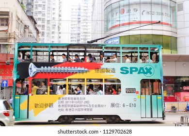 HONG KONG OCTOBER 2011 - Hong Kong cheap transportatiob, Tram, is passing by Fortress Hill area and use regularly for daily activities