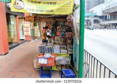 HONG KONG OCTOBER 2011 - A girl is selling magazine and newspaper in a downtown during summer day in Hong Kong