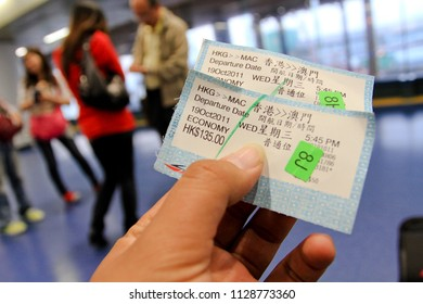 HONG KONG OCTOBER 2011 - Speed boat passenger is holding their boarding pass ticket before departing to Macau during summer season