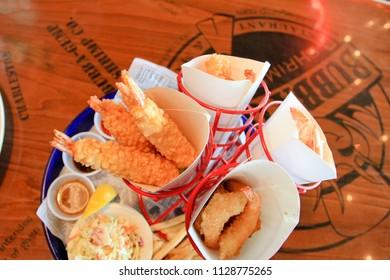 HONG KONG OCTOBER 2011 - Visitor is ordering fried shrimp menu set during lunch time in the Peak Hong Kong