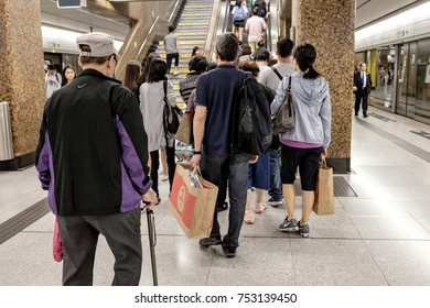 HONG KONG - OCTOBER 22, 2017_Unidentified passengers in Hong Kong subway system at rush hour