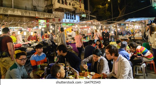HONG KONG - OCTOBER 23:Temple Street :It is known for its night market and one of the busiest flea markets at night in the territory. October 23 ,2013 in Hong Kong