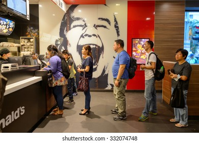 HONG KONG - OCTOBER 25, 2015: interior of McDonald's restaurant. McDonald's primarily sells hamburgers, cheeseburgers, chicken, french fries, breakfast items, soft drinks, milkshakes, and desserts