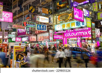 HONG KONG - October 31 : Mongkok at night on October 31, 2014 in Hong Kong, China. Mongkok in Kowloon is one of the most neon-lighted place in the world and is full of ads of different companies.