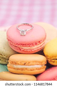 Hong Kong - October 5 2013: The engagement diamond ring on macaron.