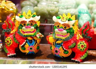 Hong Kong - October 6,2018: Chinese paired guardian lions known as lion dogs, foo dogs, shishi. Colorful amulet for home. Chinese style handmade clay lion. Souvenirs from asian travel. Selective focus