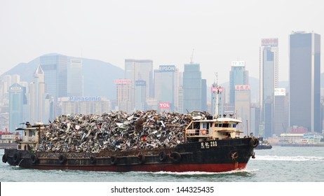 HONG KONG - OCTOBER 8: Garbage being hauled on boat in Victoria Harbor October 8, 2012 in Hong Kong, China. The dense population means its existing landfills are expected to be full by 2015.
