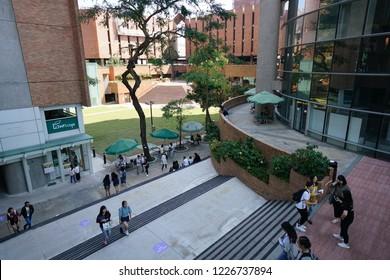 The Hong Kong Polytechnic University, Hung Hom, Kowloon, Kong Kong - 6 October 2018: Students traveling in campus.